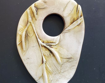 ivory color pendant,  oval botanical, image of leaves