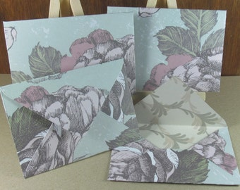 4 A7 Handmade envelopes in pale duck egg with pink roses, coloured inside