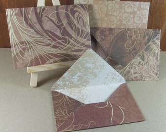 4 A7 Handmade envelopes in chocolate and tan flourishes, coloured inside
