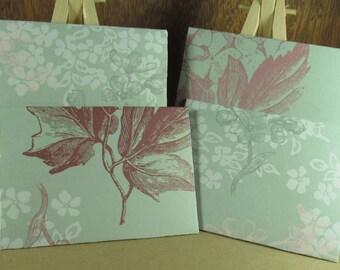 4 A7 Handmade envelopes in duck egg blue hydrangea pattern, coloured inside