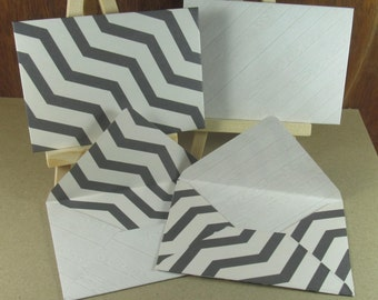 4 A7 Handmade envelopes in grey chevrons and bleached wood effects, coloured inside