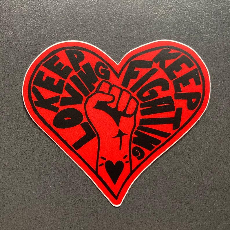STICKERS keep loving keep fighting die cut heart shape red image 0