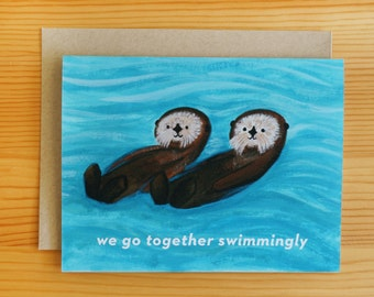 Sea Otters Together Greeting Card