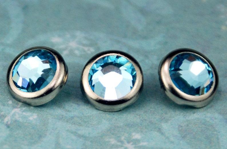 10 Aquamarine Crystal Hair Snaps  Round Silver Rim Edition  image 0