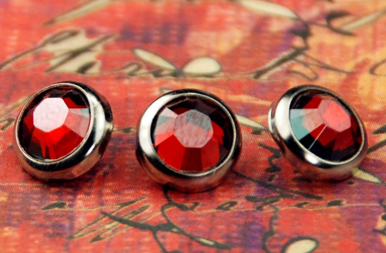10 Red Magma Crystal Hair Snaps  Round Silver Rim Edition  image 0