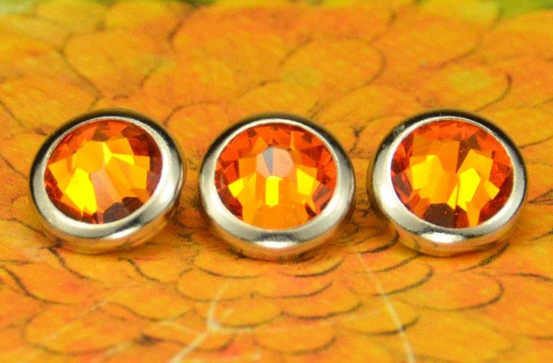 10 Tangerine Crystal Hair Snaps  Round Silver Rim Edition  image 0