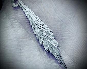 Real Marijuana leaf cast pendant in fine silver
