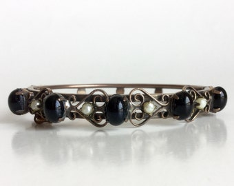 Antique Copper Bracelet w Black Oval Cabs, Seed Pearls, Scrolls - Vintage Victorian Revival Bangle Signed by Hobe - Hinge and Safety Chain