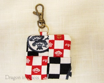 Earbud Holder - Black, Red, and Off-White Guitar Pick Holder, Flowers on checked background, Asian Fabric Keychain Pocket with Swivel Clip