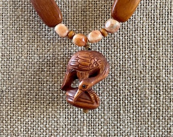 Hand carved wood heron pendant on wood agate necklace