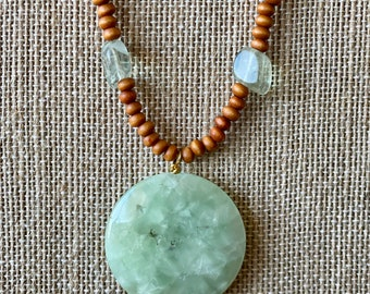 Julia Lee, designer, fluorite, crystal, Czech glass, wood beaded necklace with light green agate pendant bead