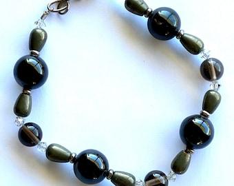 Black hypersthene, pyrite, Swarovski crystal bracelet.