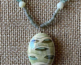 Hand blown glass focal bead pendant on serpentine bead necklace with mother of pearl and Czech glass