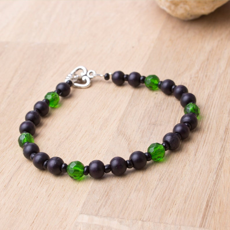 Wood bead bracelet  black wooden beads with green glass image 0