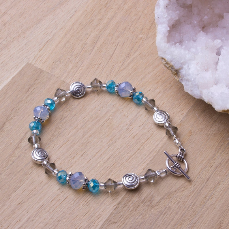 Opalite and blue bead bracelet with spiral details  Beaded image 0