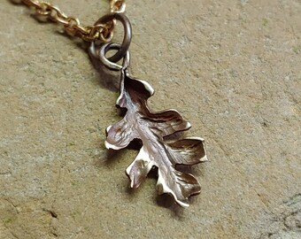 Tiny bronze oak leaf pendant on a 22 inch chain