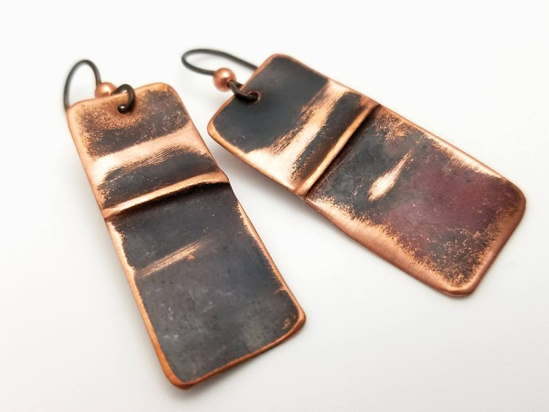 Abstract copper rectangles with a folded line industrial image 0