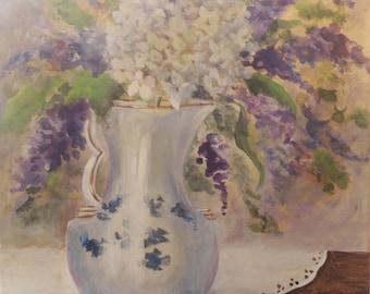 Antique vase of Hydrangeas and purple flowers