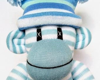 Blue and white striped Sock Monkey with removable pom pom hat ce certified