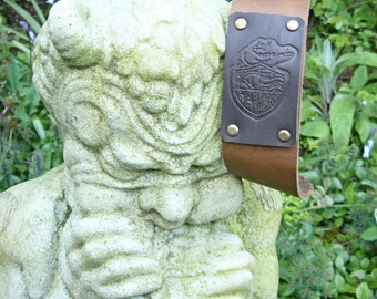 Lost Girls Pirate Academy Logo Embossed Leather Wrist Strap