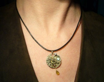 Steampunk pendant -- real gemstones & pocket watch works