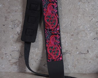 Peacock Ribbon over Black Leather Guitar Strap