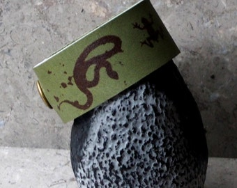 "The ""Half Off Ragnarok"" images on leather wrist strap"