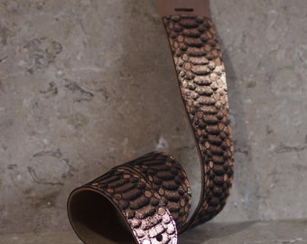 Rose Gold Scales over Black Leather Guitar Strap