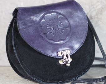 Plum Blossum crest embossed purple and black leather purse