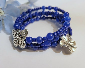 Cobalt Blue Stack Wrap Bracelet with Butterfly and Flower Charms, Layering Bracelet, Adjustable Memory Wire