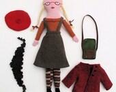 School girl doll in red