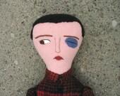 boy with black eye doll