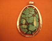 Hammered sterling  silver and turquoise pendant on chain