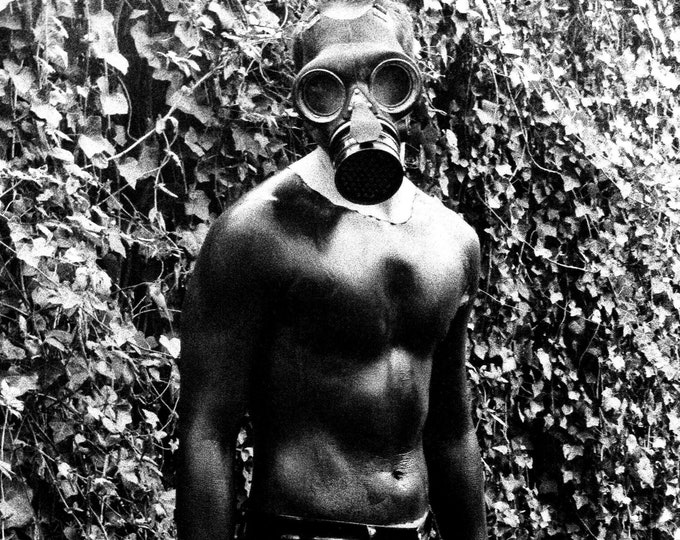 Black and White Gas Mask Photograph