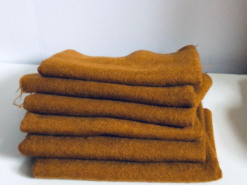 14 yard  Caramel 100 percent wool for Rug Hooking Listing is for 1 piece I have 6 pieces if you need more.