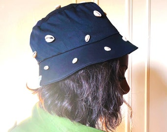 Shell trimmed Bucket hat, Cotton Twill and Cowrie shells