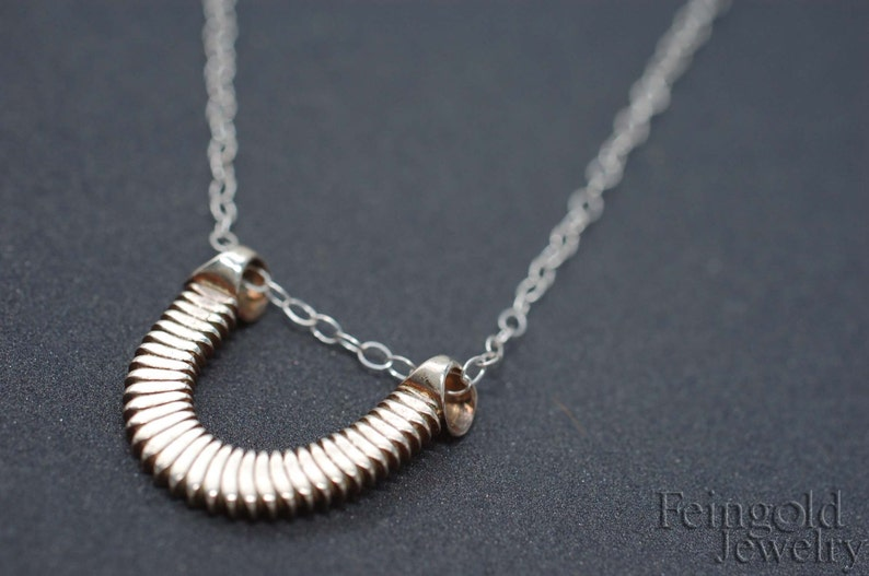 Clavicle Collection: Tiny Luck Pendant in Sterling Silver  image 0