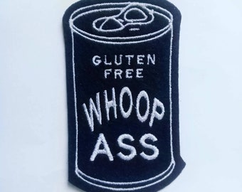 Iron on Patch Can of Gluten Free Whoop Ass Applique in black felt with white embroidery thread