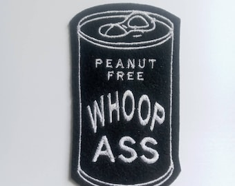 Iron on Patch Can of Peanut Free Whoop Ass Applique in black felt with white embroidery thread