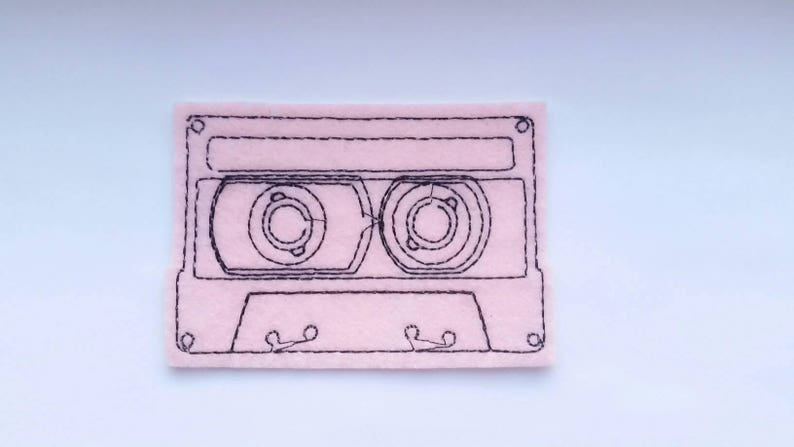 Light pink and black embroidered cassette tape iron on felt image 0