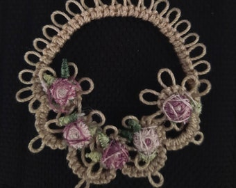 Round wreath-style tatted trimmed embellishment with dainty pastel flowers.  You can order only 1 or as many as you like.