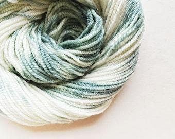 SEA CREAM hand dyed yarn speckle. choose your base from fingering, sock, dk, or bulky yarn. merino pale grey green verdigris white yarn