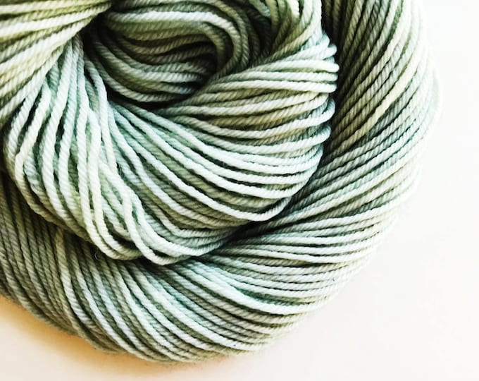 Featured listing image: VERDIGRIS hand dyed yarn mini skein