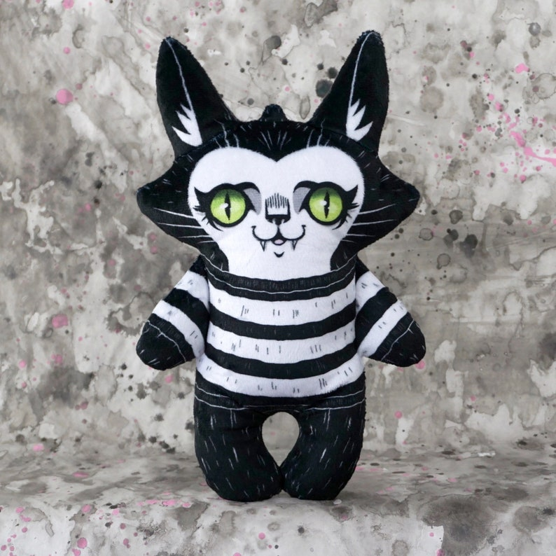 Spooky Cute Cat Doll in a striped sweater  black and white image 0
