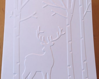 Embossed deer in forest holiday cards.