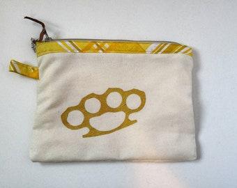 Brass knuckles sundry bag