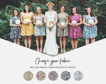 baaa81d22fa Mismatched floral bridesmaids dresses coordinating tea dress cap sleeve  vintage style floral print summer wedding colourful bright