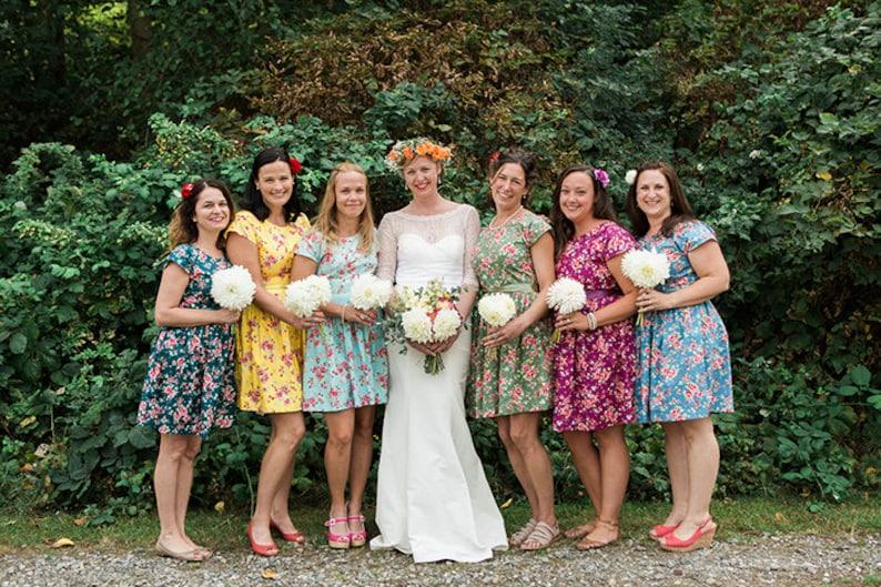 Floral bridesmaids dresses mismatched coordinating tea dress cap sleeve vintage style floral print summer wedding colourful bright