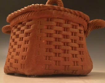 Basket weave lidded container