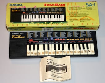 Casio SA-1 Keyboard 100 Sounds Synthesizer in Box with Manual Vintage 1990s